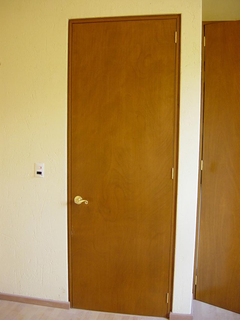 Dise o integral en madera puertas for Puertas de tambor modernas
